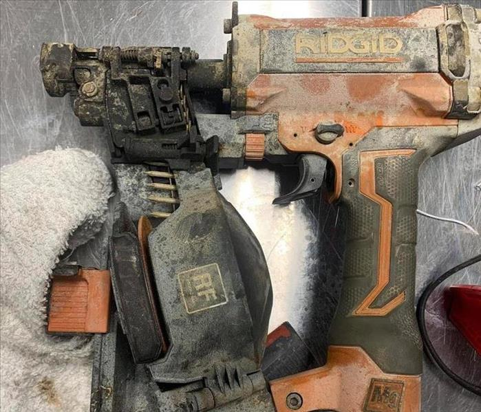 soot covered nail gun